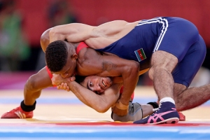 Cuba's Livan Lopez Azcuy fights with Azerbaijan's Jabrayil Hasanov for the bronze medal of the Men's 66Kg Freestyle wrestling at the ExCel venue during the London 2012 Olympic Games